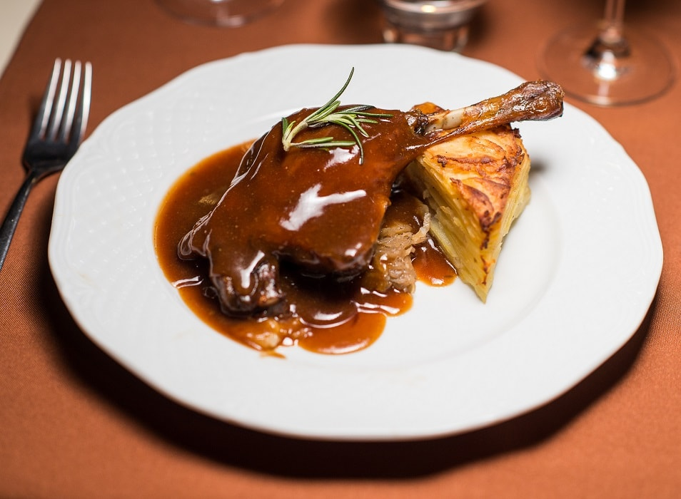 Duck Leg Confit with Crispy With Cabbage and Gratin Potatoes